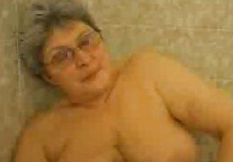 Hot granny having fun in the bath