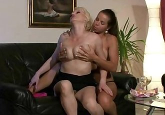 Horny mom with strap-on seduces his GF