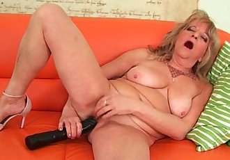 Grandmother With Large Breasts Pushes A Huge Dildo Into Her Old Pussy